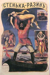 Movie poster with a bearded man holding a woman in a dress over his head.